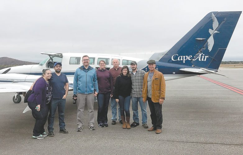 Cape Air holds a community open house event on Saturday, bringing interested members of the Saranac Lake community up in one of their small planes for a flyover. From left are Chantal Munoz, Esteban Munoz, Joshua Reap, Kelly Reap, Peter Hagner, Carolyn Bordonaro, Mike Barillari and Saranac Lake village Mayor Clyde Rabideau. (Photo provided)