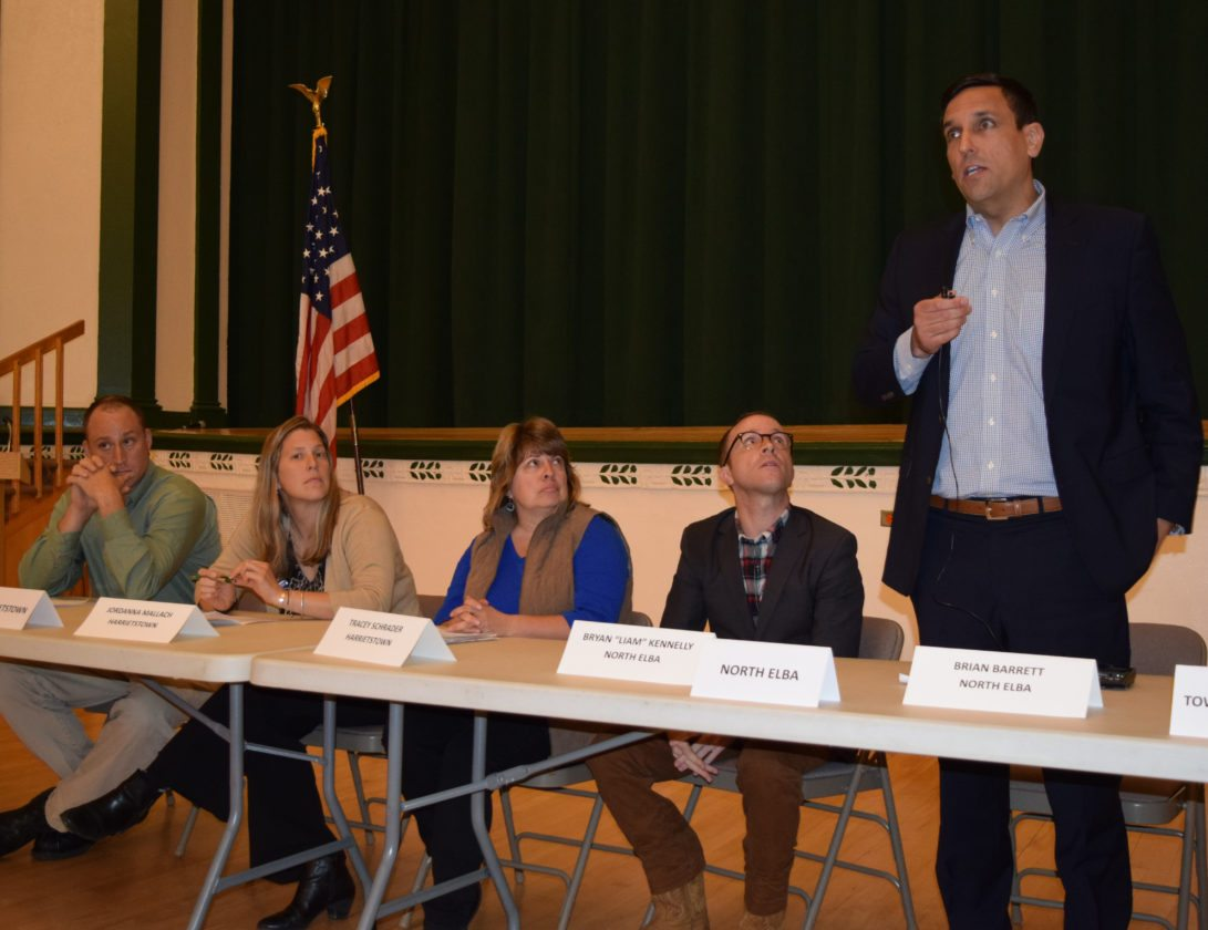 "Jacob Vennie-Vollrath, Jordana Mallach, Tracey Schrader and Bryan ""Liam"" Kennelly listen to North Elba superintendent candidate Brian Barrett at a Voters for Change forum on Monday night at Harrietstown Town Hall.  (Enterprise photo — Glynis Hart)"