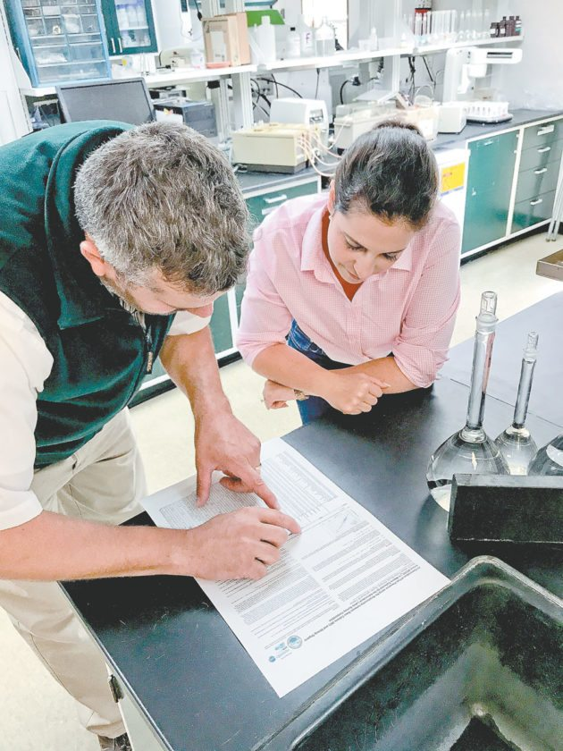 Jed Dukette, left, and Rep. Elise Stefanik look over data at the Adirondack Lake Survey Corporation's lab behind the state Department of Environmental Conservation headquarters in Ray Brook. (Photo provided by ALSC)