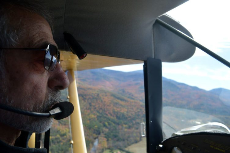 Bob Rose pilots his 1949 Piper Clipper airplane in the High Peaks Wilderness on Oct. 17. (Enterprise photo — Antonio Olivero)