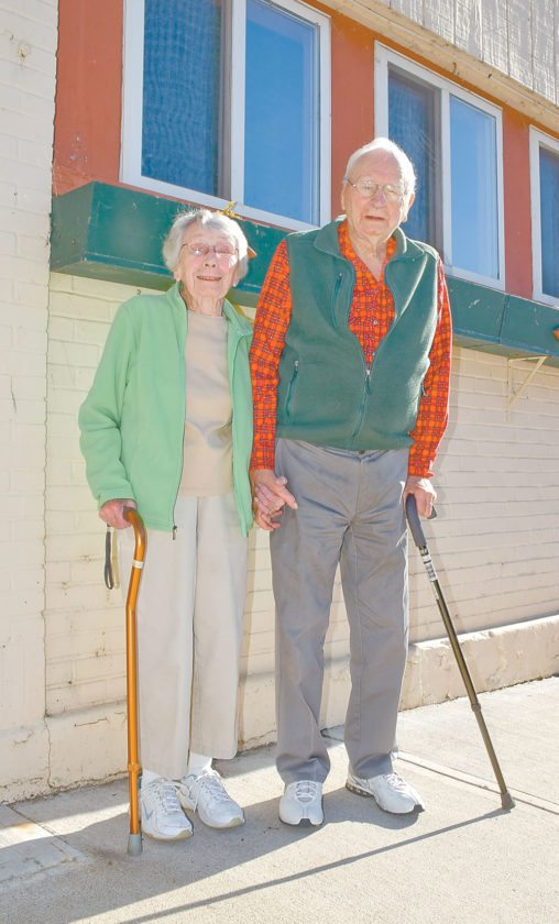 Lucille and Alton Beideck, married for 75 years, stand in front of the Enterprise Thursday.  (Enterprise photo — Glynis Hart)