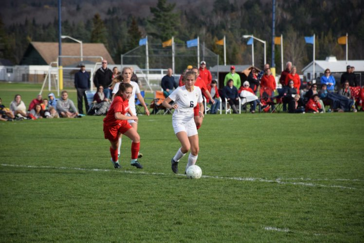 Lake Placid junior Mackenzie Kondrat takes the ball toward the Wildcat net in the second half of Thursday's win in Lake Placid. Kondrat went on to score the only goal of the match. (Enterprise photo — Justin A. Levine)