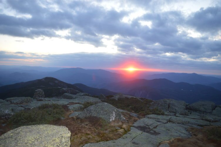 The sun sets on another warm, sunny October day Thursday, as seen here from the summit of Ampersand Mountain, accessed by a trailhead on state Route 3 between Saranac Lake and Tupper Lake. Ampersand is one of the Saranac Lake 6er peaks. (Enterprise photo — Antonio Olivero)