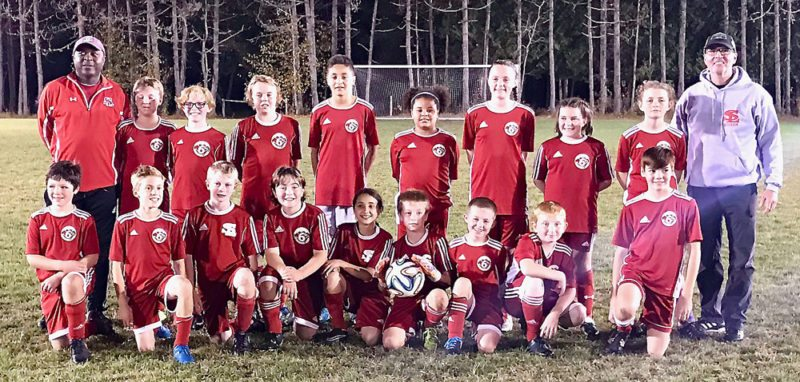 The Saranac Lake 6ers Soccer Club's fifth- and sixth-grade team completed another successful season last weekend with a tournament under the lights at the Paul Smith's College soccer field. Kneeling, from left, are Mason Stoddard, Pasha Barclay, Dillon Wilson, Dustin Burke, Gabriella Allen, Cole Van Etten, Alex Evans, Cameron Kenison and Liam Noble.Back row, from left: coach Tony Small, Nash Carlisto, Owen Keal, Kellan Duffy, Marcus Navarra, Ayla Small, Phoebe Peer, Addison Dann, Lucy Thill and coach Peter Van Etten. (Photo provided)