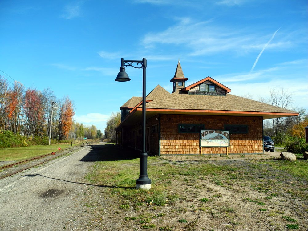 """The depot at """"Next Stop Tupper Lake"""" is the proposed switching point where rail-trail riders would get off a train and on the trail. (Enterprise photo — Aaron Cerbone)"""