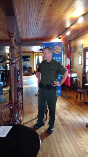 Captain John Streif briefs the Rotary Club of Saranac Lake on both the routine of rescues of hikers lost in the High Peaks to the fortunately not-so-routine such as the apprehension of the escaped convicts from Dannemora in 2015. (Photo provided)