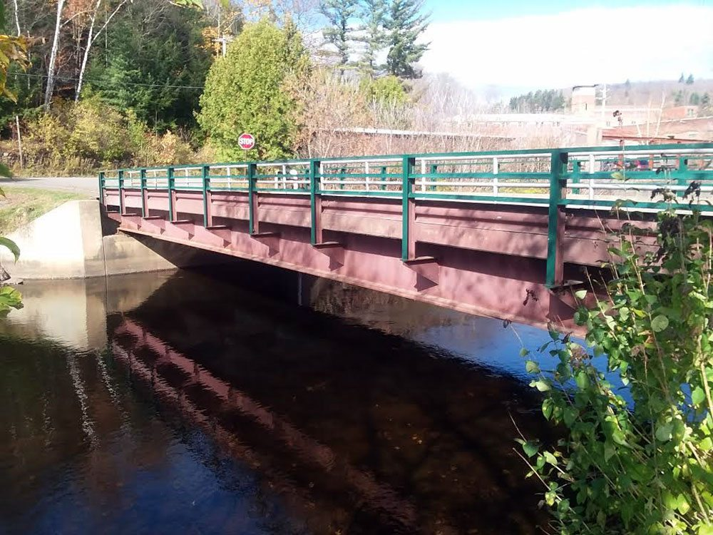 Known in state databases as Parking Lot Drive,, this bridge in Saranac Lake, between Dorsey Street and a village parking lot, is classified as structurally deficient.  (Enterprise photo — Glynis Hart)