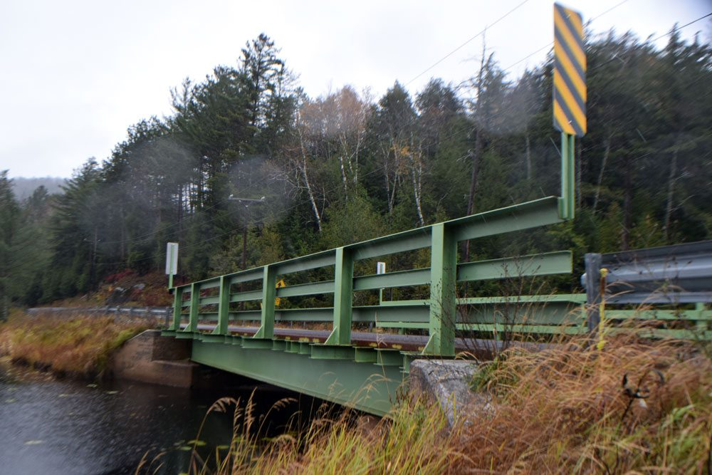 """Wawbeek Road crosses Panther Swamp on this classic steel-deck bridge, built in 1960. It's 15.4 sufficiency rating classifies it as """"structurally deficient."""" (Enterprise photo — Glynis Hart)"""