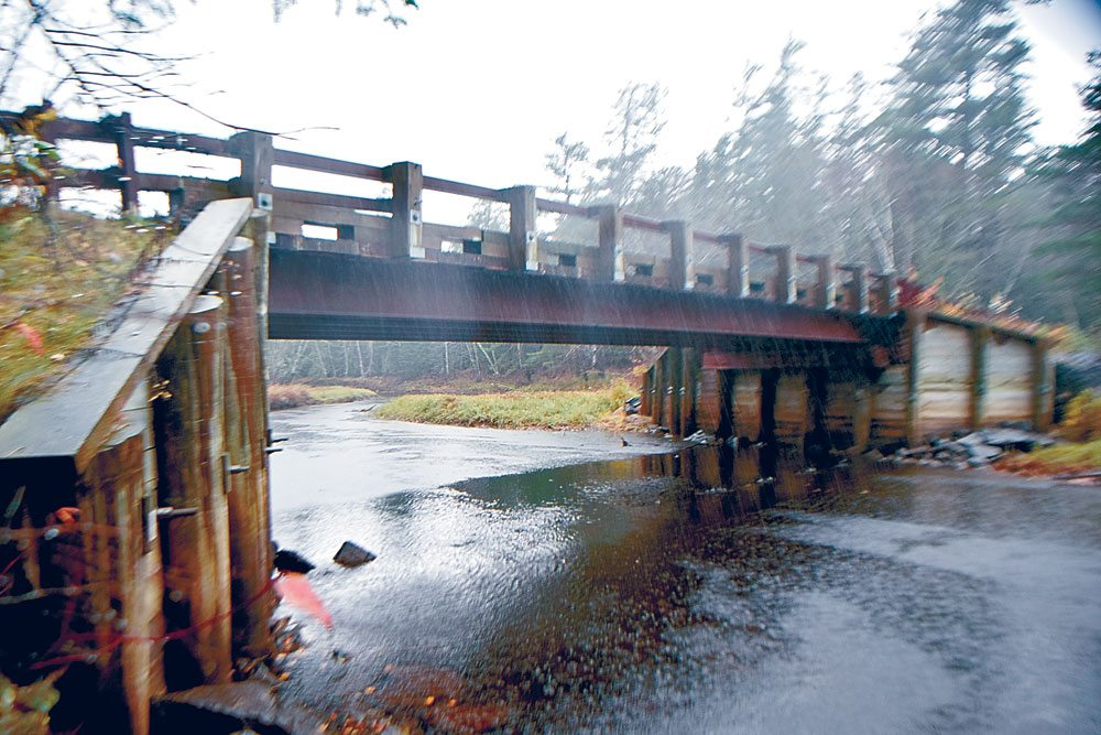 """The Coreys Road bridge over Stoney Creek was built in 2003, but because of its steel and timber construction, it is deemed """"functionally obsolete."""" (Enterprise photo — Glynis Hart)"""