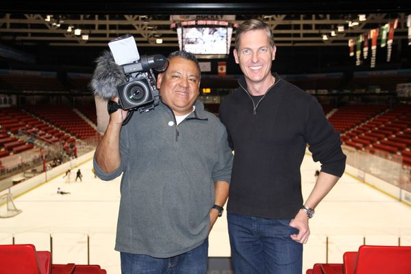 Photojournalist Nefty Gonzalez, left, and Anchor/Reporter Brian Curtis of KXAS-TV NBC5 News, Dallas-Forth Worth, pose at the Olympic Center Oct. 18 after conducting an interview that will air leading up to the 2018 Olympic Winter Games in Pyeongchang, South Korea.  (Enterprise photo — Andy Flynn)
