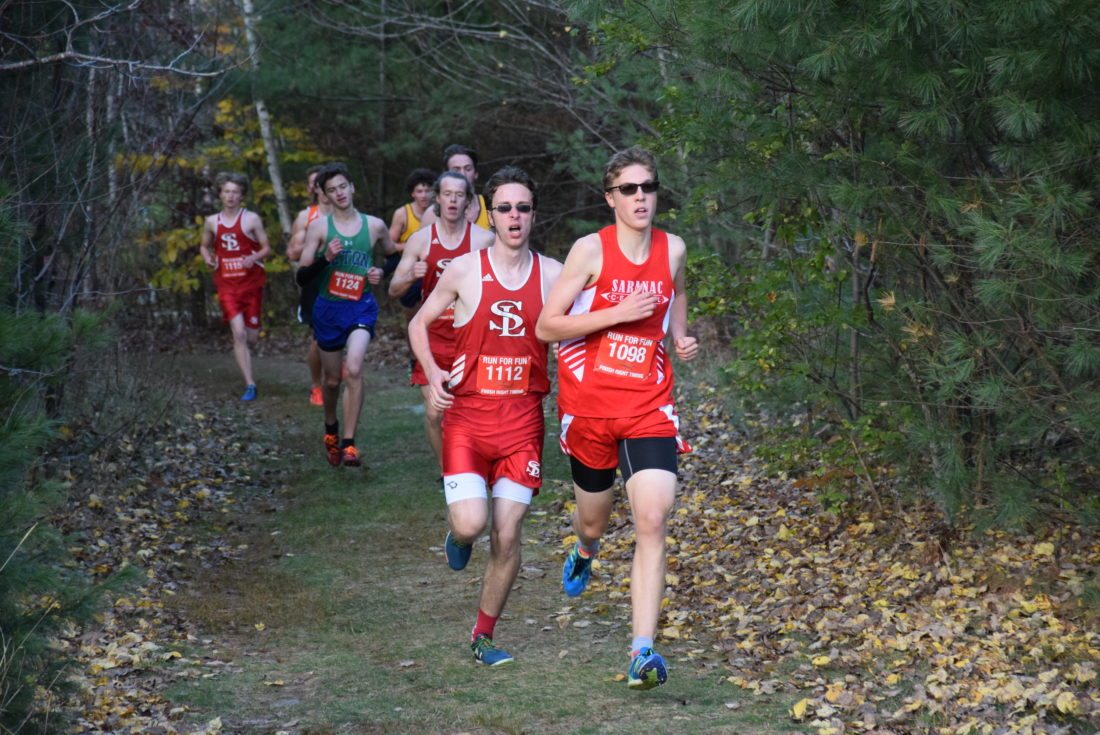 The Champlain Valley Athletic Conference cross country championships were held Friday at the Cadyville Recreational Park. Saranac Central's Andrew LePage and Saranac Lake's Anderson Gray lead a pack of runners on their way to a 1-2 finish in the race. (Enterprise photo — Justin A. Levine