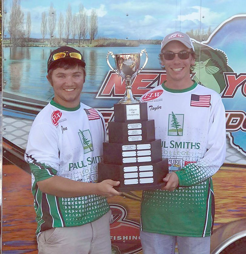 Jon Herrman and Taylor West pose with The Bass Federation championship trophy for New York State on Oct. 1. The pair won the state championships on Lake Champlain with a combined total weight of 20.41 pounds on five bass. With the win, West and Herrman qualified to represent New York State in The Bass Federation Collegiate Nationals in 2018. The men won $1,000 in the championship, and have earned more than $1,200 for the program so far this fall. (Photo provided)