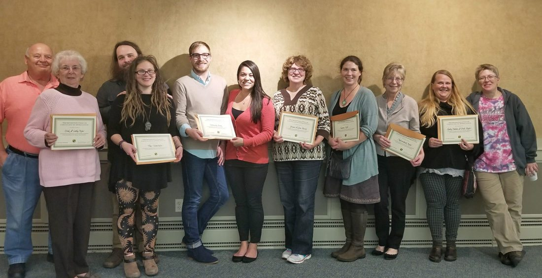 """The 2017 VIS """"Keep Saranac Lake Blooming"""" award winners are pictured, from left: Dick and Cathy Mose, Kiki Sarko and Eric Munley (the Waterhole), Trevor Beaudette and Beth Devaney (Community Bank), Yvonne Parrish, Andrea Hill, Susan Mueller (Adirondack Motel), and Kathy Fadden and Beth Hogle. (Photo provided)"""