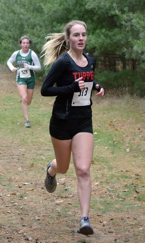 Tupper Lake sophomore Sandra Kwasniak runs through the trees during the Section X cross country race Wednesday in Brushton. Kwasniak qualified for the state championships with her performance. (Enterprise photo — Justin A. Levine)