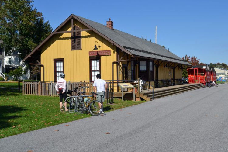 The train station in New Freedom, Pennsylvania, is seen after being renovated.(Photo provided by Carl Knoch) [Editor's note: An earlier caption incorrectly said the tracks here have been turned into a trail. In fact, this station is served by both a trail and a train. The Enterprise editor wrote the erroneous caption based on a misunderstanding that the author's essay implied.]