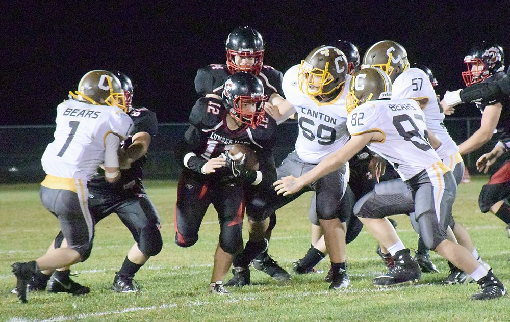 Tupper Lake running back Skyler Pickering finds a hole while picking up yards against Canton during a Section X regular season game. The 'Jacks tangle with Moriah tonight at 7 p.m. in Clintonville. (Enterprise photo — Justin A. Levine)