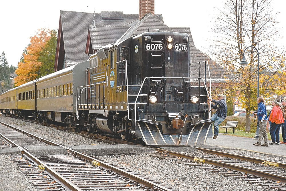 The Adirondack Scenic Railroad's engine pulls out of the Saranac Lake train depot in fall 2016 on its way down to the Utica area for winter storage. (Enterprise photo — Justin A. Levine)