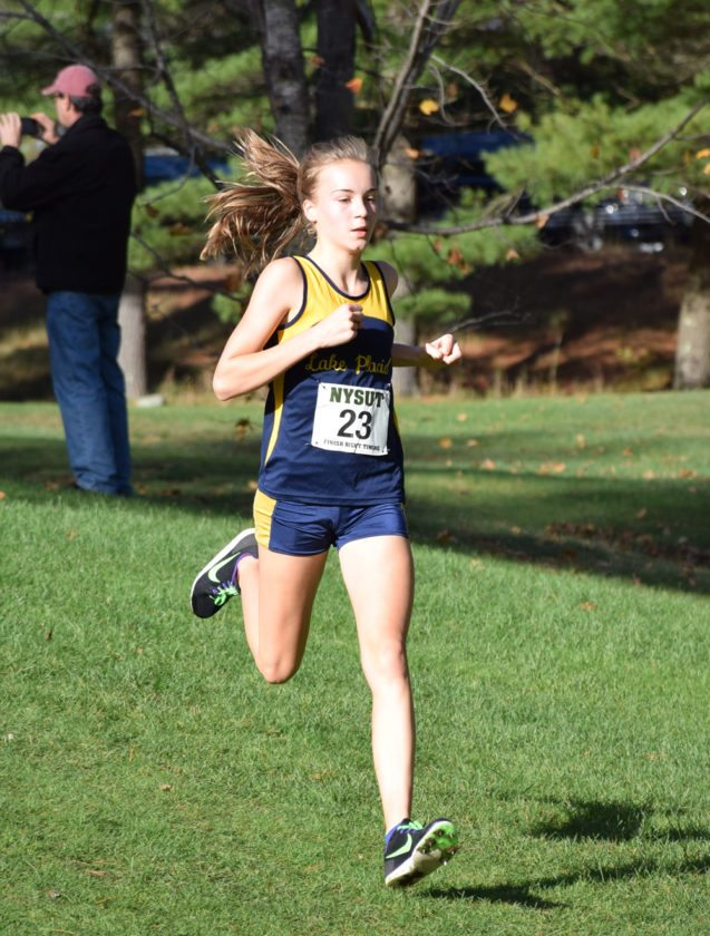 Lake Placid eighth-grader Annie Rose-McCandlish races to a fourth-place overall finish Friday at Cobble Hill Golf Course. (Enterprise photo — Justin A. Levine)