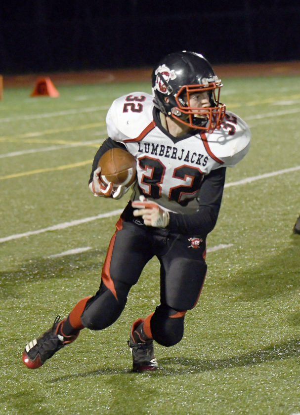 Tupper Lake senior Ryeleigh Shore spins toward the sideline after he scooped up a Moriah fumble during Friday's game in Clintonville. (Enterprise photo — Lou Reuter)