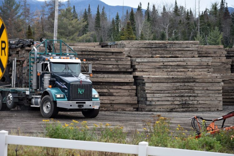 Approximately 4,200 wooden beams are stacked near Old Military Road in Lake Placid Tuesday to aid in replacing six utility poles on the line along the railroad tracks that feeds Lake Placid's electrical needs. (Enterprise photo — Griffin Kelly)