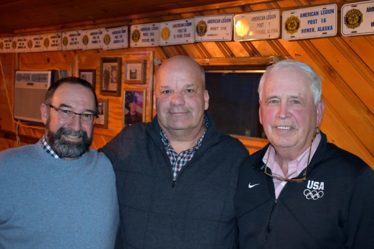 From left North Elba Councilmen Derek Doty and Jack Favro and Supervisor Roby Politi celebrate their re-election wins Tuesday night at American Legion Post 326 in Lake Placid. (Enterprise photo — Griffin Kelly)