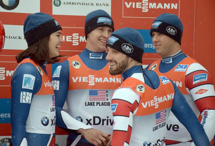 From left, Summer Britcher, Tucker West, Jayson Terdiman and Matt Mortensen react after claiming the bronze medal in last year's World Cup luge team relay at Mount Van Hoevenberg, outside of Lake Placid.  (Enterprise file photo — Justin A. Levine)