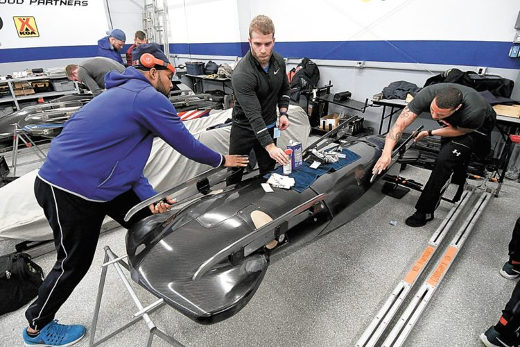 From left, Ryan Bailey, Sam Michener and Chris Kinney, three of a dozen push athletes on the U.S. men's bobsled team, work on their sled Wednesday in preparation for today's season-opening World Cup event at Mount Van Hoevenberg. Action kicked off this morning with women's skeleton, followed by men's and women's two-man bobsled this afternoon. Men's skeleton and another two-man bobsled event will take place Friday.  (Enterprise photo — Lou Reuter)