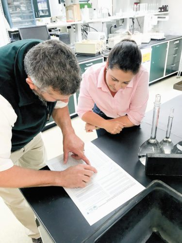 Jed Dukett, left, and Rep. Elise Stefanik look over data at the Adirondack Lake Survey Corporation's lab behind the state Department of Environmental Conservation headquarters in Ray Brook. (Photo provided by ALSC)