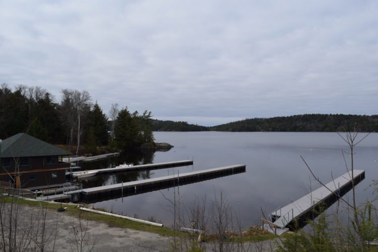 Crescent Bay Marina on Lower Saranac Lake is seen this week as developers  discovered their purchase of the marina did not include the lake bottom itself, throwing a wrench into future plans. (Enterprise photo — Glynis Hart)