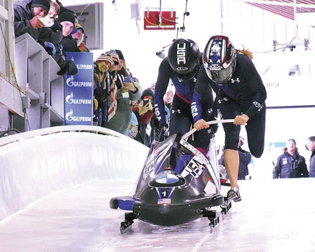 Jamie Gruebel Poser, front, and Aja Evans push at the start of their women's World Cup two-man bobsled run Thursday at the Mount Van Hoevenberg Olympic Complex. The duo finished fourth in the event, while the American team of Elana Meyers Taylor and Lauren Gibbs took the silver behind Canadians Kaillie Humphries and Melissa Lotholz. (Enterprise photo — Justin A. Levine)