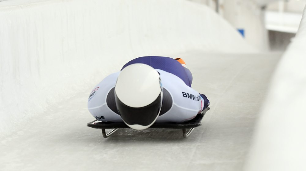Matt Antoine of the United States slides on the straightaway during the second run of Friday's World Cup men's skeleton race at Mount Van Hoevenberg. Antoine had the top result among three Americans, finishing eighth. (Enterprise photo — Lou Reuter)