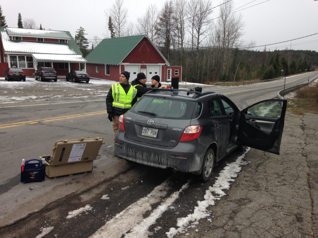 State police personnel work Monday morning to reconstruct a collision between this Toyota Matrix and a pedestrian, who died, on state Route 86 at the intersection of Old Ray Brook Road. (Enterprise photo — Peter Crowley)
