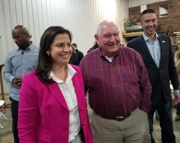 U.S. Secretary of Agriculture Sonny Perdue, center, smiles with Rep. Elise Stefanik, R-Willsboro, Monday at King Brothers Dairy Farm in Northumberland, Saratoga County. Michael Bittel, right, led a question-and-answer session. (Photo provided — Adam Colver, Post-Star)