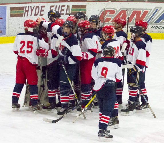 The Saranac Lake Placid Midget team beats North Franklin at home Sunday, Nov. 5 to secure a spot at the New York State Amateur Hockey Association state championship tournament in Buffalo in March.  (Photo provided)