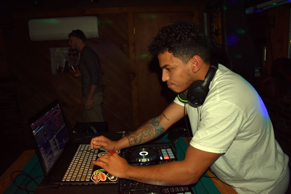 "DJ Alex ""Funky Cold"" Medina provides the entertainment for the night with his digital mixer/scratcher and a laptop full of hits.  (Enterprise photo – Griffin Kelly)"