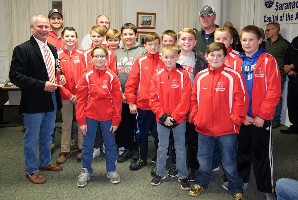 "Coaches and players of the PAL football team were recognized by Saranac Lake Mayor Clyde Rabideau at Monday's village board meeting for ""outstanding performance and sportsmanship thanks to an exceptional season.""  (Enterprise photo — Glynis Hart)"