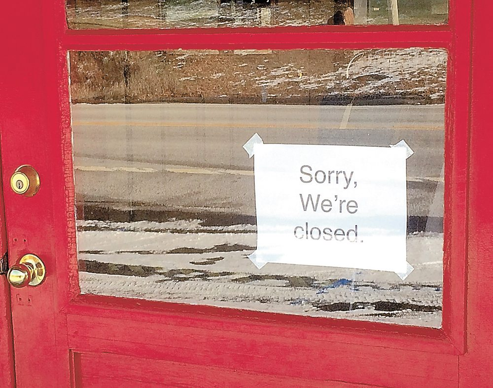 A sign on the door of the Lake Store in the hamlet of Sabael, town of Indian Lake, announces the recent closure of the store and Smith Cabins.  (Photo provided — Bill Quinlivan)