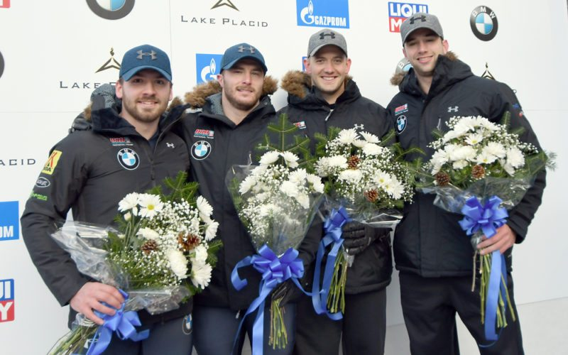 Americans, from left, Codie Bascue, Sam McGuffie, Justin Olsen and Evan Weinstock celebrate following last Friday's two-man World Cup bobsled competition at Mount Van Hoevenberg in Lake Placid. Bascue and McGuffie took home the gold medal, while Olsen and Weinstock earned a bronze in the race. (Enterprise photo — Lou Reuter)