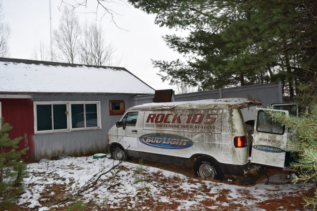 An abandoned Rock 105 van sits at the former Radio Park in Saranac Lake, which will be up for auction Nov. 29. (Enterprise photo — Glynis Hart)