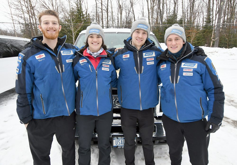 USA Luge national team members, from the left, Jonny Gustafson, Summer Britcher, Tucker West and Taylor Morris stand in front of their van at Mount Van Hoevenberg after getting in some spring sliding in March.   (Enterprise photo — Lou Reuter)
