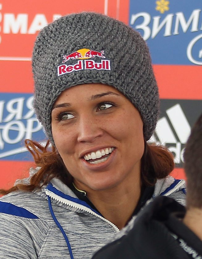 Brakeman Lolo Jones of the United States looks on during a flower presentation following the women's bobsledding World Cup event Dec. 7, 2013, in Park City, Utah. Jones and her pilot Jamie Greubel tied for second place.  (AP photo — Rick Bowmer)