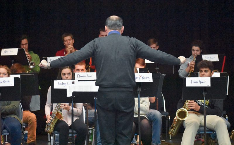 Tim Savage conducts the jazz ensemble for the Area All-State Music Festival Friday in Lake Placid. Students in the front row, from left, are Rebecca Bonville, Haley Gonyea, Mary Keating and Hunter Ansan. (Enterprise photo — Griffin Kelly)