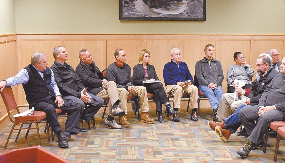 From left, Regional Office of Sustainable Tourism CEO James McKenna, Olympic Regional Development Authority CEO Mike Pratt, Wilmington town Supervisor Randy Preston, Adirondack Park Agency Commissioner Art Lussi, Bid Director Darcy Norfolk, North Elba town Supervisor Roby Politi, North Elba Councilman Jay Rand, Athlete Minder CEO Mara Smith and village of Lake Placid Mayor Craig Randall gather Monday in the Conference Center at Lake Placid to address public concerns with the Adirondack North County Global Sports Committee's upcoming bid to host the Winter World University Games.   (Enterprise photo — Griffin Kelly)