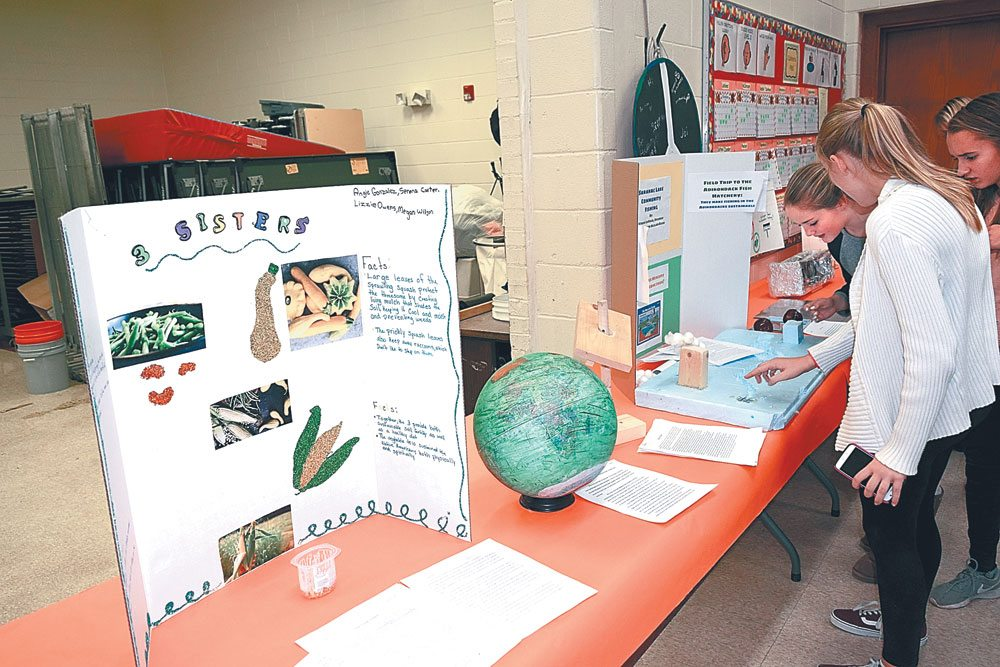 Students' sustainability projects are seen at Saranac Lake Middle School's Harvest Dinner Wednesday evening, Nov. 15. (Enterprise photo — Glynis Hart)