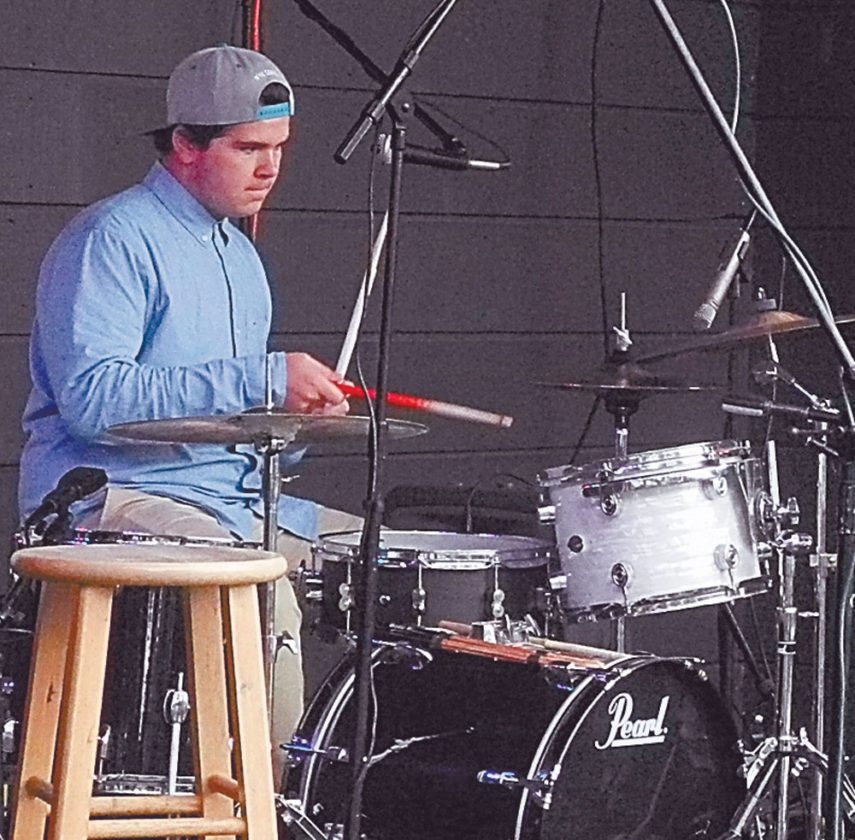 "Saranac Lake Middle School student Carson Ryan, seen playing drums at Hobofest Sept. 3, wrote his sustainability project about drumsticks. ""One medium-sized maple tree can produce 24 pairs of sticks,"" he wrote. ""If you walk into a music store you can see that their [sic] are hundreds of sticks, which means a lot of trees were cut down. But were those trees planted back?"" (Enterprise photo — Aaron Cerbone)"