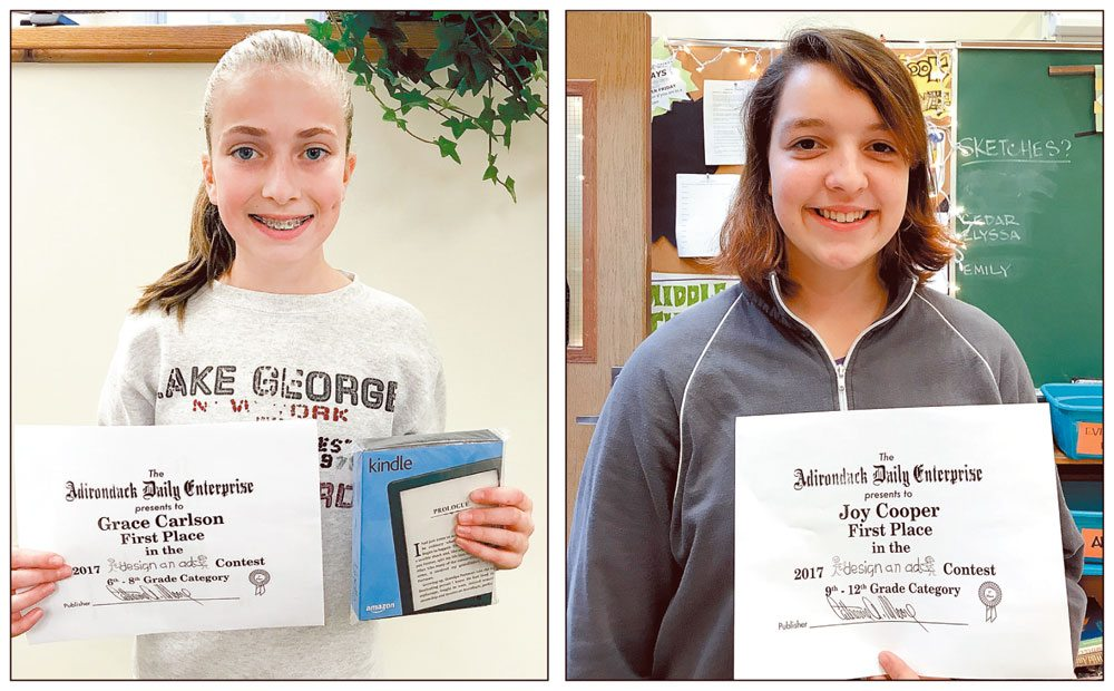 First-place winners for the Enterprise's annual Design-An-Ad Contest were Grace Carlson (left), in grade 7 at Lake Placid Middle School, Joy Cooper (right), grade 9 at Keene Central School, and Anita Hulshoff, grade 5 at Lake Placid Elementary School, who was unavailable for a photo as she has moved away. Each student picked a business or organization and designed an advertisement for it. They had to include art, text and the business logo and contact information. There were three age categories: first through fifth grade, sixth through eighth grade, and ninth through 12th grade.  (Enterprise photos — Catherine Moore)