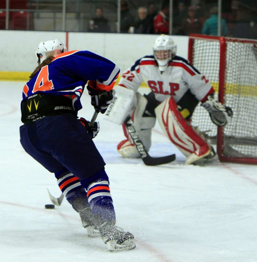 SLP freshman goaltender Whitney Battistoni guards the net as Potsdam's Erica Sloan skates in during the first period of Tueday night's game at the Olympic Center in Lake Placid. Battistoni turned away 30 of the 34 shots she faced in the game. (Provided photo — Roy Bombard)