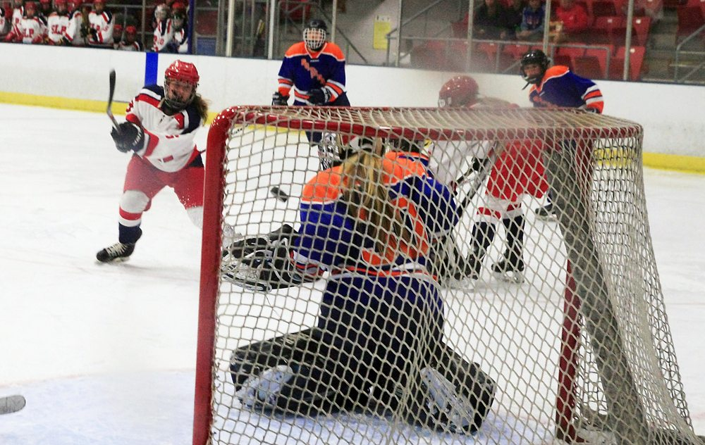 SLP's junior Lea Hill fires a shot past Potsdam senior goalie Taylor Razis during the second period of Tuesday's game at the Olympic Center in Lake Placid. SLP senior Tess Stanton was credited with the assist on the play. (Provided photo — Roy Bombard)