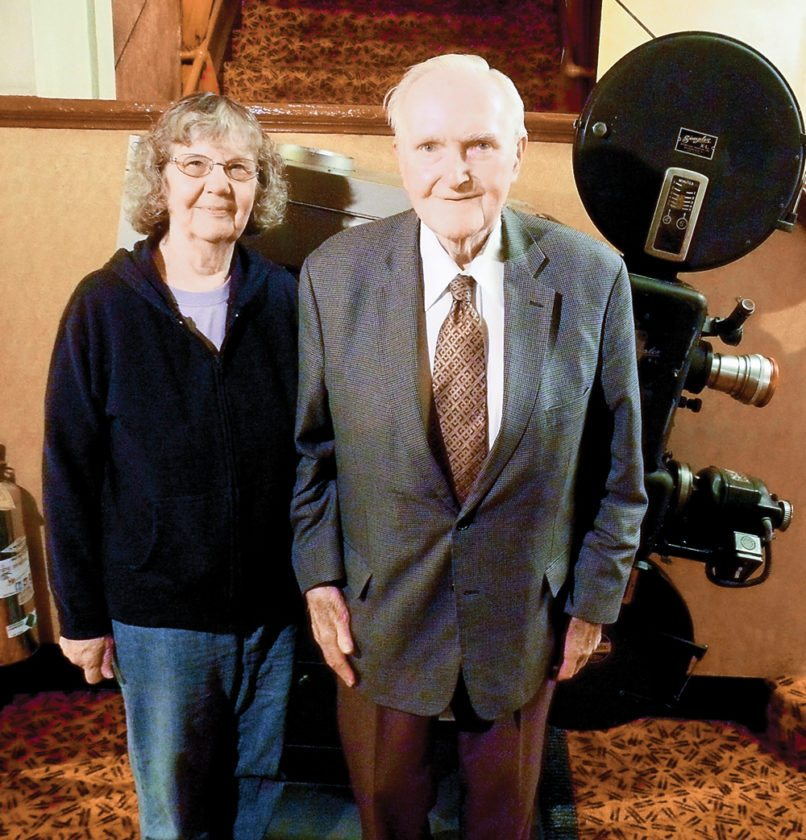 Reg and Barbara Clark have owned Lake Placid's Palace Theater since 1961, raising their family to take tickets, serve popcorn and change film. Three generations of Clarks now work there. (Enterprise photo — Aaron Cerbone)