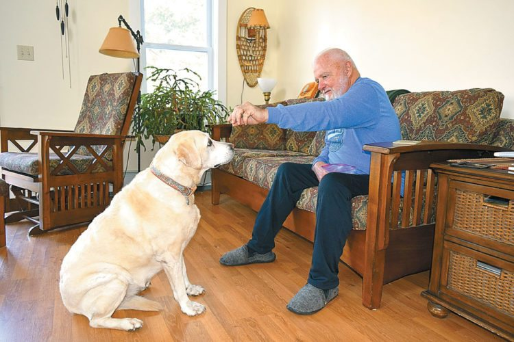 Ruby and Bruce Landon sit in their living room in Saranac Lake. (Enterprise photo — Glynis Hart)